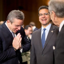 Puerto Rico Gov. Alejandro García Padilla, left, accompanied by Resident Commissioner for Puerto Rico Pedro Pierluisi, center, gestures as he meets with Senate Judiciary Committee Chairman Sen. Chuck Grassley, R-Iowa, in Washington, D.C., on Dec. 1, 2015, prior to his testimony before the committee's hearing on Puerto Rico's fiscal problems.