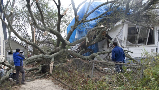 Insurance adjusters inspect damage to a Point Pleasant house after superstorm Sandy.