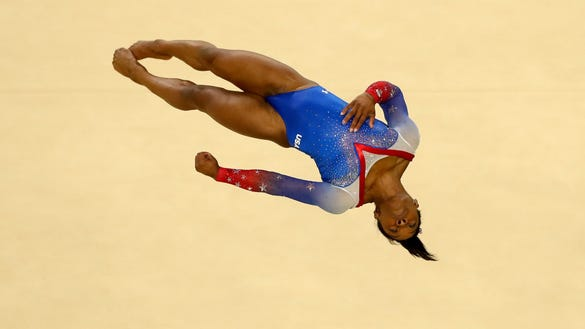 RIO DE JANEIRO, BRAZIL - AUGUST 16: Simone Biles of the United States competes on the Women's Floor final on Day 11 of the Rio 2016 Olympic Games at the Rio Olympic Arena on August 16, 2016 in Rio de Janeiro, Brazil. (Photo by Dean Mouhtaropoulos/Getty Images) ORG XMIT: 631391497 ORIG FILE ID: 590193572