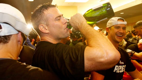 SAN FRANCISCO, CA - OCTOBER 11: President of Baseball Operations for the Chicago Cubs, Theo Epstein, celebrates in the locker room after defeating the San Francisco Giants 6-5 in Game Four of their National League Division Series to advance to the National League Championship Series at AT&T Park on October 11, 2016 in San Francisco, California. (Photo by Ezra Shaw/Getty Images) ORG XMIT: 674957623 ORIG FILE ID: 614072232