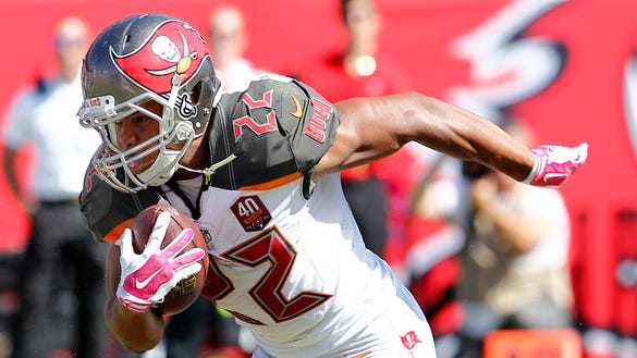 Oct 11, 2015; Tampa, FL, USA; Tampa Bay Buccaneers running back Doug Martin (22) runs for a first down during the second half of an NFL football game Jacksonville Jaguars at Raymond James Stadium. Tampa won 38-31. Mandatory Credit: Reinhold Matay-USA TODAY Sports ORG XMIT: USATSI-224582 ORIG FILE ID: 20151011_tdc_mb4_1924.JPG