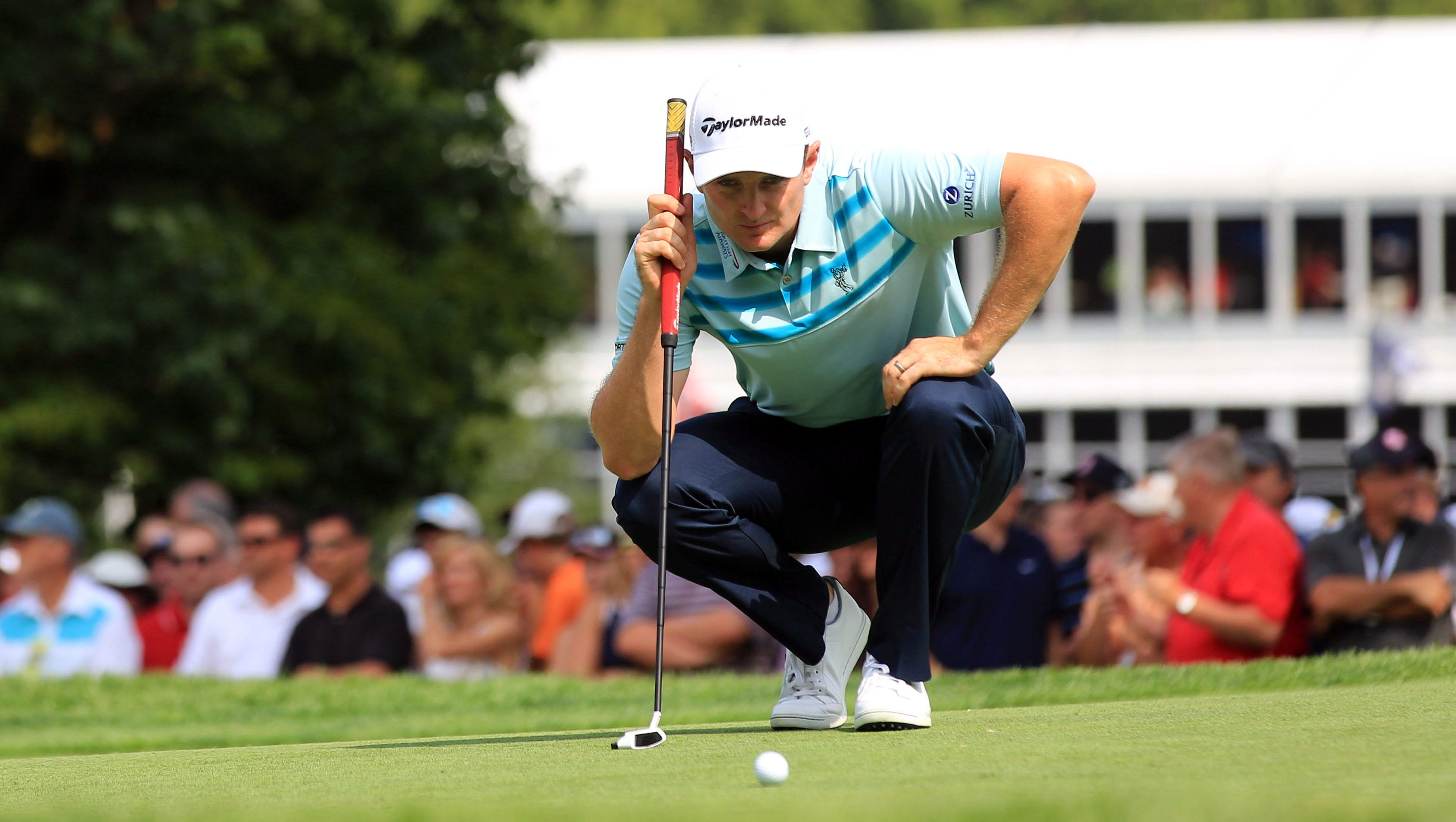 Aug 8, 2013; Rochester, NY, USA; Justin Rose lines up his putt on the 8th gren during the first round of the 95th PGA Championship at Oak Hill Country Club. Mandatory Credit: Allan Henry-USA TODAY Sports ORG XMIT: USATSI-120254 ORIG FILE ID:  20130808_pjc_ah2_249.JPG