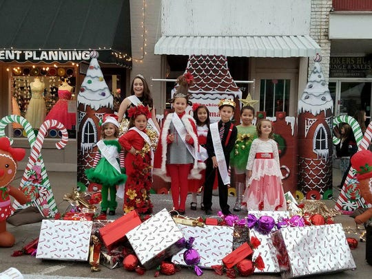 Contestants in the Little Miss and Mr. Christmas Pageant stand on stage during Olde Fashioned Christmas in this 2017 file photo.