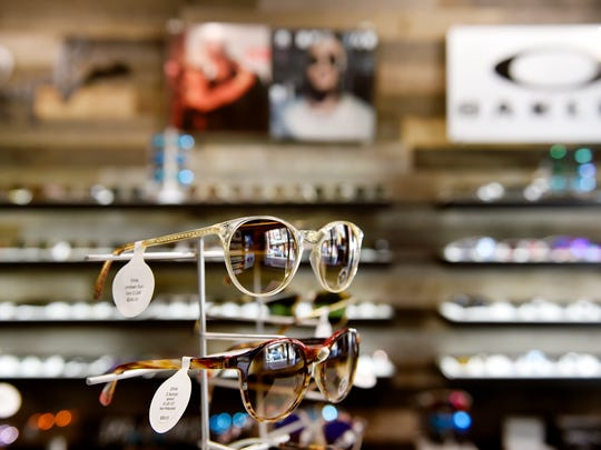 """Sunglasses are displayed at Sky Optics, as seen Thursday, Nov. 16, 2017, in York. Steve and Trish Arbetman had operated Sky Optics for about three years, selling out of display cases and online, before opening a retail space on North Beaver Street. """"We felt it was important to be part of downtown,"""" said Trish Arbetman."""
