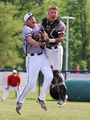 Plymouth pitcher Josh Janovsky (left) and catcher Zach Beadle celebrate the final out against Canton.