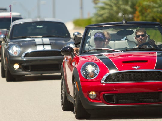 Mini drivers ride back over the Midpoint Bridge to The Tilted Kilt after attending a program for Operation Open Arms in Cape Coral.