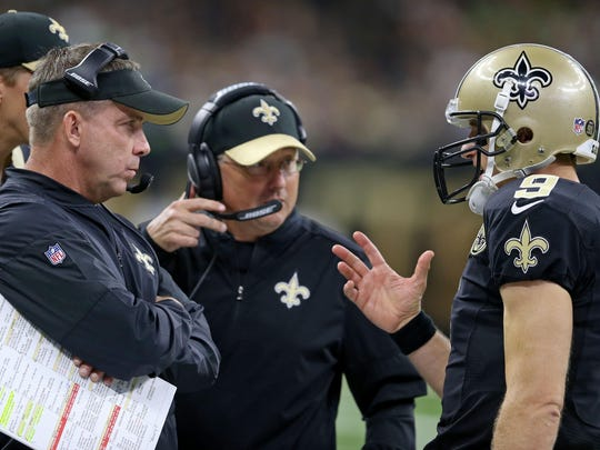 Oct 30, 2016; New Orleans, LA, USA; New Orleans Saints quarterback Drew Brees (9), right, talks to head coach Sean Payton, left, and offensive coordinator Pete Carmichael against the Seattle Seahawks in the second half at the Mercedes-Benz Superdome. The Saints won, 25-20. Mandatory Credit: Chuck Cook-USA TODAY Sports