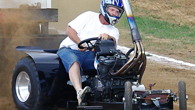 Greg Lindsey, competing with the Tennessee City Mini Tractor Puller, in 2013 at the Dickson County Fairgrounds.