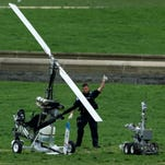 A Capitol Police officer flashes a thumbs up after inspecting the gyrocopter Doug Hughes flew onto the Capitol lawn April 15.