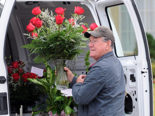 Lenny Benoit makes his deliveries on Valentine's Day Tuesday, Feb. 14, 2012, in Lafayette.