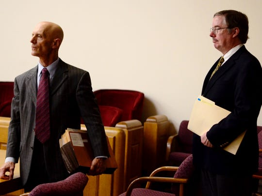 Matthew Carter, senior vice president at People's United Bank, right, and the bank's attorney Douglas Wolinsky appear in Vermont Superior Court in Burlington on Tuesday, August 17 to confirm the foreclosure sale of the former Burlington College campus.
