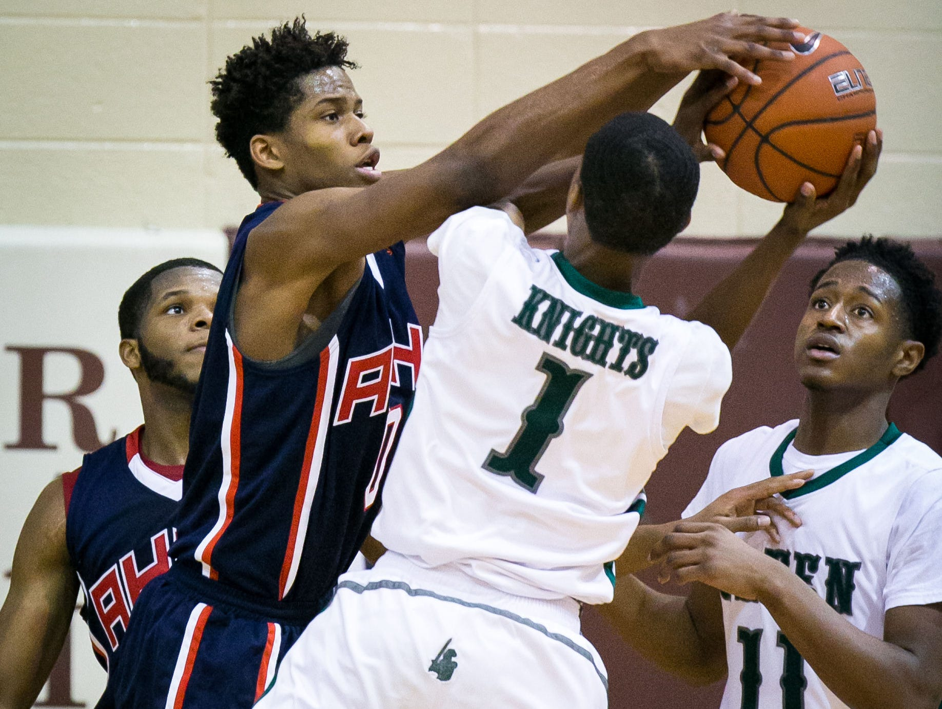 Yvens Monfluery (left) of American History blocks Sharif Holland of Mount Pleasant as he drives to the basket.