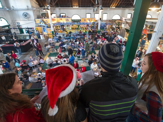 From left: Brooke Patterson, April Marion, Ben Eisenhour and Mya Gurreri sing Christmas songs in the balcony at Central Market.