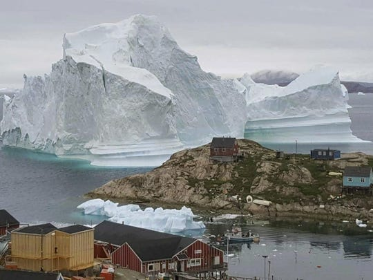 Scientists have watched an iceberg four miles long break off from a glacier near the village Innarsuit, on the northwestern Greenlandic coast.