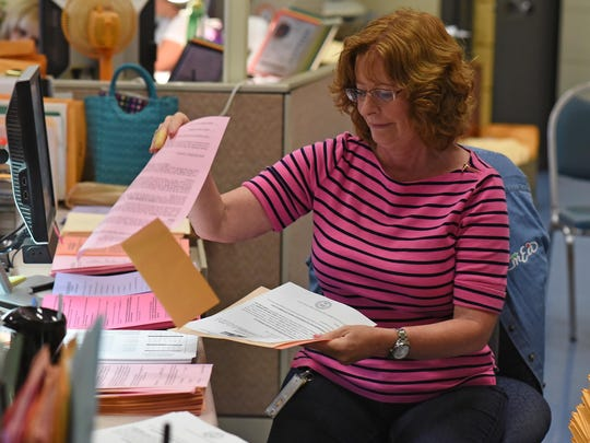 Arlene Sartorio, a secretary of Millville Senior High School preparing student packets before school starts on Sept. 2nd. Aug. 25, 2015. Staff photo/Craig Matthews