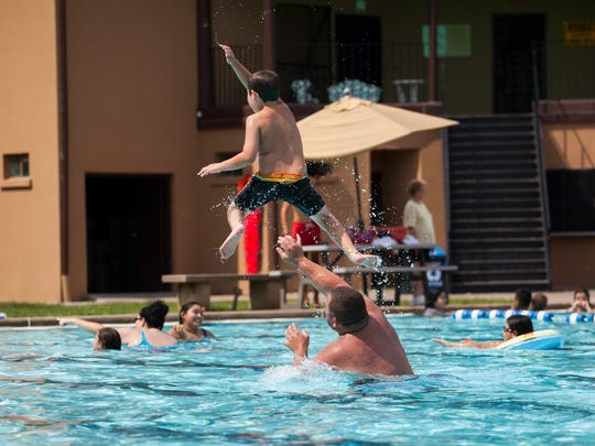 A young swimmer goes airborne at the Gypsy Hill Park pool on Saturday, Aug. 15, 2015.