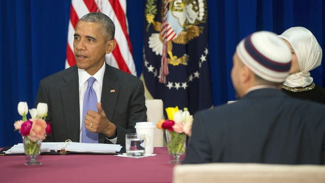 President Obama meets with members of Muslim-American community at the Islamic Society of Baltimore Wednesday. Obama is making his first visit to a U.S. mosque at a time Muslim-Americans say they're confronting increasing levels of bias in speech and deeds.