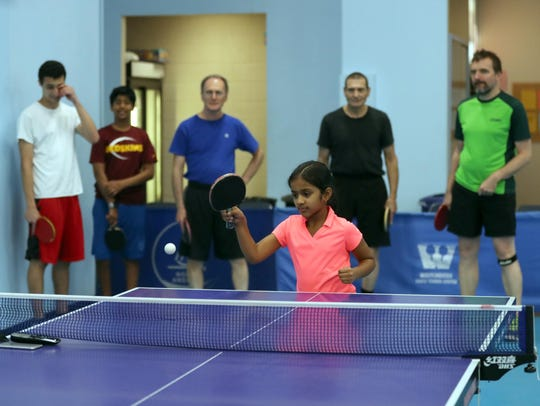Parvathy Gopikrishna, 8, of Croton, plays table tennis