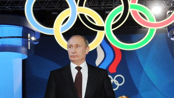 In this 2011 photo, then Russian Prime Minister Vladimir Putin speaks at a meeting marking the 100th anniversary of the Russian Olympic Committee in Moscow.