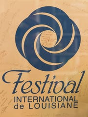 A poster from the first Festival International, signed by African musicians, at the home of Phil Lank, co-founder of the festival in Lafayette March 31, 2016