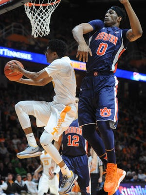 Tennessee guard Detrick Mostella (15) leaps toward the basket as Auburn forward Horace Spencer (0) defends on Feb. 9, 2016.