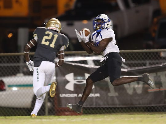 Godby's Cleveland Blackshear catches a ball against Lincoln's Jalen Glaze defense during their game at Cox Stadium on Friday.