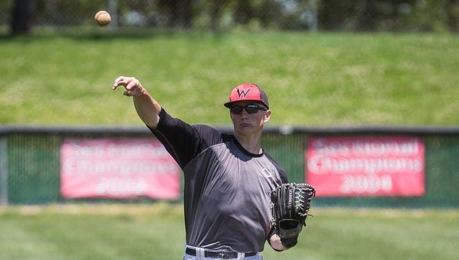 Wapahani's Alec Summers throws during practice at Wapahani High School Wednesday, May 31, 2017.