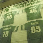 These Spartan wrestling banners cost $250 apiece at the MSU Surplus Store. The school replaced them with new versions.