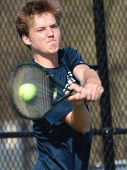 Granville's Raleigh Conway returns a shot against Marietta