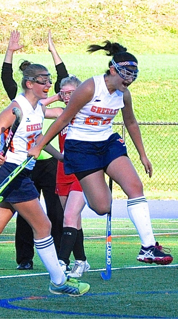 Horace Greeley's Lauren Neff leaps in celebration after