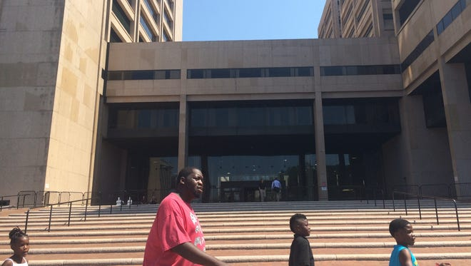 Passers-by walk in front of the Justice Center Complex in Cleveland. The Cleveland Municipal Court isn't as busy as expected this week during the Republican National Convention, due to a relatively peaceful event through Wednesday afternoon.