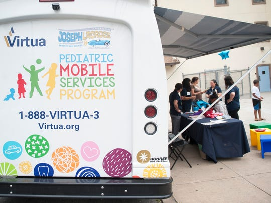 Virtua's Pediatric Mobile Services Program unit is stationed in front of the Anna M. Sample House in Camden on Wednesday, June 27, 2018.