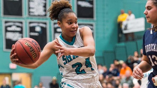 Gulf Coast High School's Yasmeen Chang tries to get