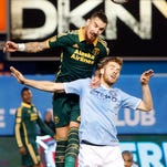 Portland Timbers' Dairon Asprilla (11), celebrates with teammate Alvas Powell, right, after scoring against New York City FC on Sunday at Yankee Stadium in New York.