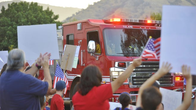 In remembrance of 9/11, more than 200 people filled the streets in downtown Springville to wave in crews fighting the Pier Fire. The fire has grown to 27,000 acres and is 60 percent contained.