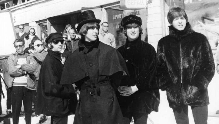The Beatles' Ringo Starr, left, George Harrison, John
