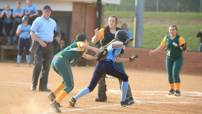 Reynolds' Cami McLaughlin tags out Enka's Kloyee Anderson on Tuesday night in Candler.