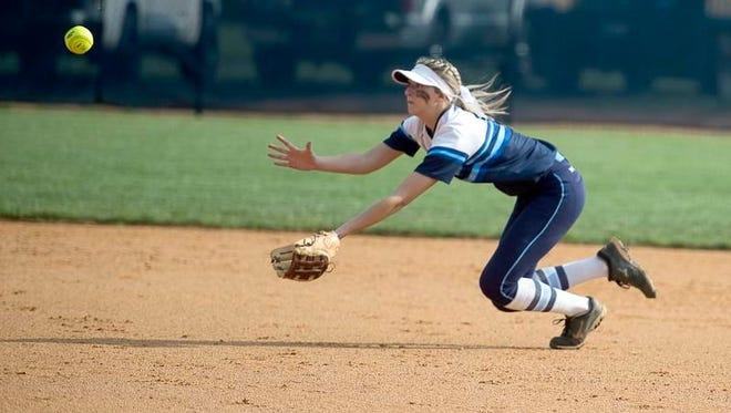 Enka's Kloyee Anderson dives to match a catch Wednesday in Candler.