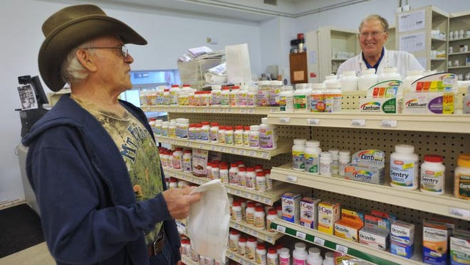 Pharmacist Dick Dovidas talked to a customer in 2014 at the Blue River Pharmacy in Shelbyville, where Dovidas said he kept careful control over pseudoephedrine sales.