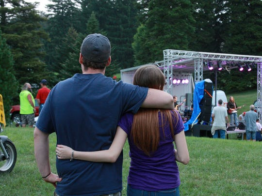 A couple listens to the band at the Fountain Stage at Leilapalooza Saturday evening