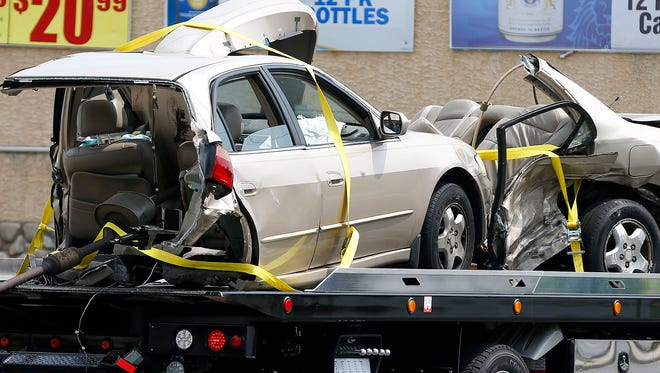 One of the vehicles involved in a multi-vehicle accident on Corlies Avenue (Route 33) at Union Avenue in Neptune is towed from the scene Friday, July 28, 2017.