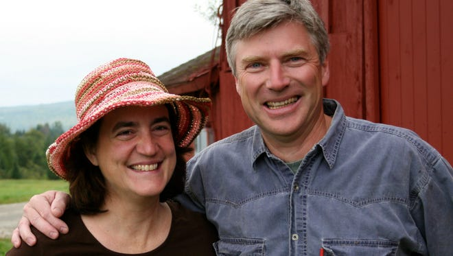 Eleanor Leger, right, co-owner of Eden Ice Cider in Newport, Vt., with her husband, Albert, says the Affordable Care Act allowed her husband to work full time for their company.