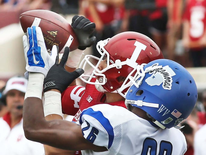 Travon Claybourne of ISU  breaks up this pass intended for IU's Ricky Jones in the third quarter. Indiana University defeated Indiana State University 28-10 in a football game at Memorial Stadium in Bloomington Saturday August 30, 2014.