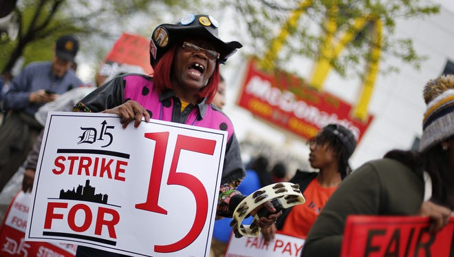 In this May 15 file photo, Velma Cornelius protests for higher wages outside a McDonald's restaurant in Detroit.