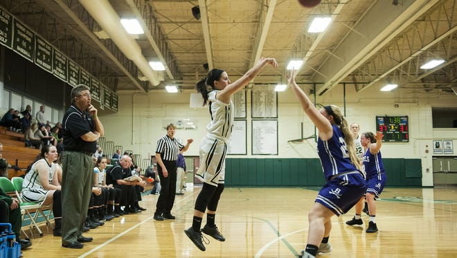 Rice's Leah Larivee (1) shoots the ball during the girls basketball game between Brattleboro and Rice on Tuesday night.