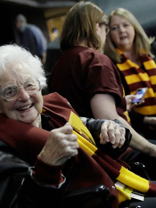 FILE - This March 22, 2018 file photo shows Sister Jean Dolores Schmidt sitting with other Loyola-Chicago fans during the first half of a regional semifinal NCAA college basketball game against Nevada in Atlanta. Sister Jean is depicted in a bobblehead and sales of the figurine have soared to the heavens. She has become a celebrity during the NCAA men's basketball tournament. As a result, the National Bobblehead Hall of Fame and Museum, in conjunction with Loyola University, last week unveiled a limited edition bobblehead. Phil Sklar with the soon-to-be-open museum in Milwaukee says within 24 hours, the bobblehead became the institution's top seller of all time. (AP Photo/David Goldman)