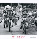 Children ride bikes during a Fourth of July parade on south Pickwick in 1984.