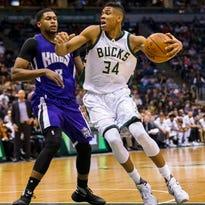 Nov 25, 2015; Milwaukee, WI, USA; Milwaukee Bucks forward Giannis Antetokounmpo (34) drives for the basket around Sacramento Kings forward Rudy Gay (8) during the third quarter at BMO Harris Bradley Center.