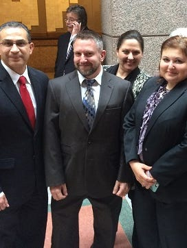 State Rep. Abel Herrero, left, with Judges David Stith and Inna Klein at the Texas Capitol on April 10, 2017.