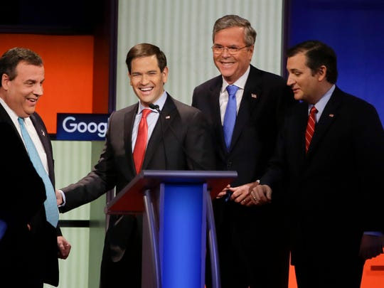 Republican presidential candidates from left New Jersey Gov. Chris Christie, Sen. Marco Rubio, R-Fla., former Florida Gov. Jeb Bush and Sen. Ted Cruz, R-Texas, talk after the Republican presidential primary debate Jan. 28 in Des Moines, Iowa.